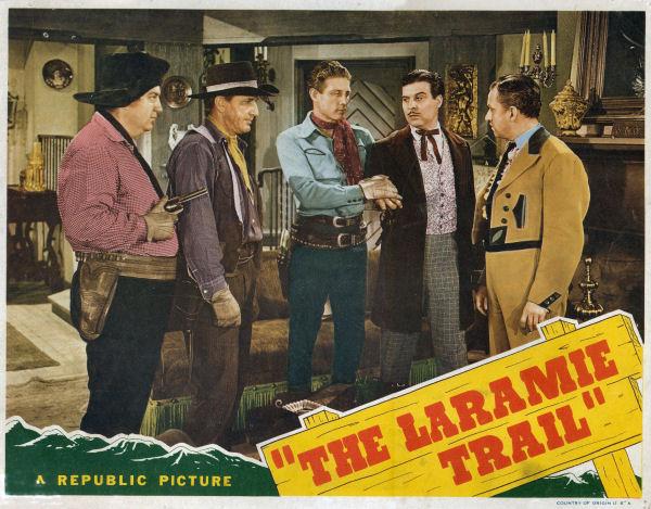 Smiley Burnette, Leander De Cordova, Bud Geary, George J. Lewis, and Robert Livingston in The Laramie Trail (1944)