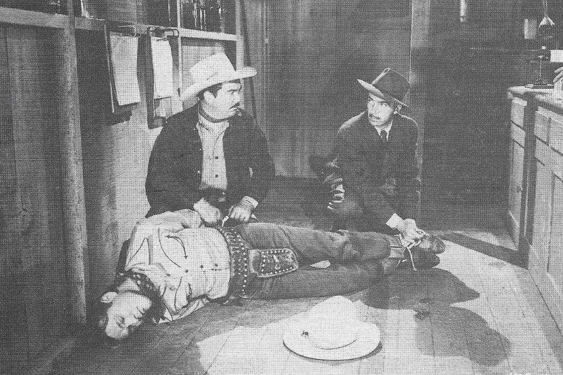 Roy Rogers, Jack O'Shea, and Bradley Page in Sons of the Pioneers (1942)