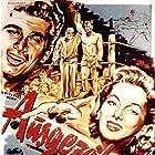 Rock Hudson, Jeff Chandler, Evelyn Keyes, Stephen McNally, and Joseph Pevney in Iron Man (1951)