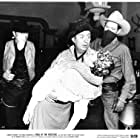 Smiley Burnette, Gail Davis, Boyd 'Red' Morgan, and Chuck Roberson in Trail of the Rustlers (1950)