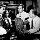 Robert Mitchum, Jane Greer, Patric Knowles, and John Qualen in The Big Steal (1949)