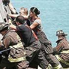 David Eigenberg, Christian Stolte, Yuriy Sardarov, and Miranda Rae Mayo in Chicago Fire (2012)