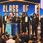Arnold Schwarzenegger, Bob Backlund, Mick Foley, Booker Huffman, Stephanie McMahon, Vince McMahon, Bruno Sammartino, Trish Stratus, Donald Trump, and Maria Menounos in WWE Hall of Fame 2013 (2013)