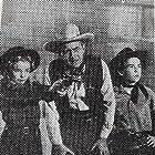 James Bell, Michael Chapin, and Eilene Janssen in The Dakota Kid (1951)