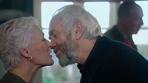 """Joan Castleman (Glenn Close) is the perfect devoted wife. Forty years spent sacrificing her own talent, dreams and ambitions to fan the flames of her charismatic husband Joe (Jonathan Pryce) and his skyrocketing literary career. Ignoring his infidelities and excuses because of his """"art"""" with grace and humor. Their fateful pact has built a marriage upon uneven compromises and Joan's reached her breaking point. On the eve of Joe's Nobel Prize for Literature, the crown jewel in a spectacular body of work, Joan's coup de grace is to confront the biggest sacrifice of her life and secret of his career."""