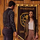 Stella Maeve and Adam DiMarco in The Magicians (2015)