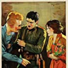 Arnold Kent, Gilbert Roland, and Norma Talmadge in The Woman Disputed (1928)