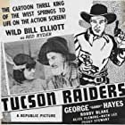 Robert Blake, Bill Elliott, and George 'Gabby' Hayes in Tucson Raiders (1944)