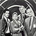 Helen Slater, Martin Landau, Jonathan Silverman, and Nicolas Surovy in 12:01 (1993)