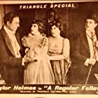 Millicent Fisher, Taylor Holmes, and Edna Phillips in A Regular Fellow (1919)