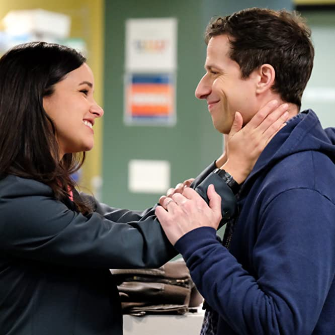 Melissa Fumero and Andy Samberg in Brooklyn Nine-Nine (2013)