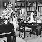 Edgar Stehli and Robert Strauss in 4D Man (1959)