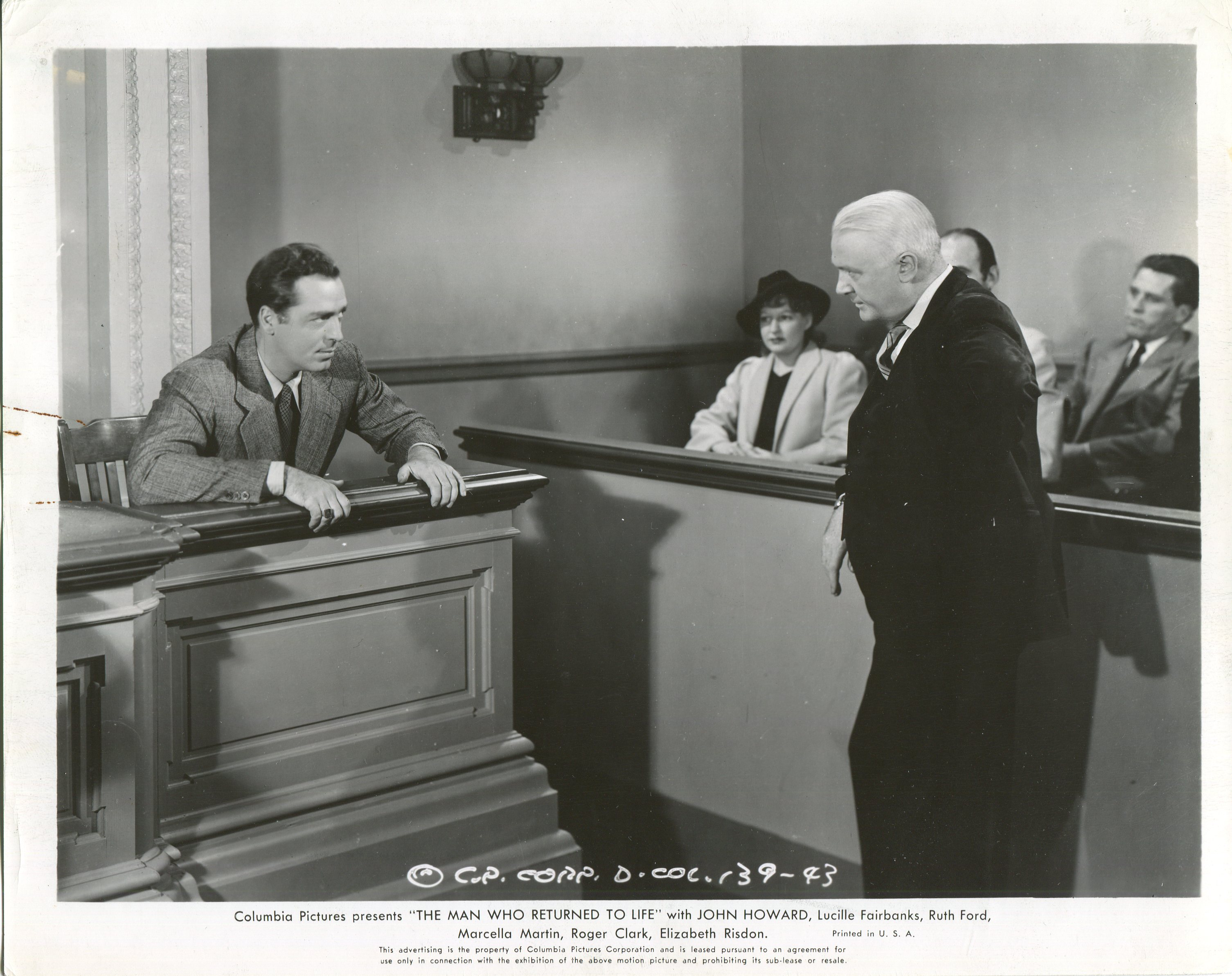 John Howard and Charles C. Wilson in The Man Who Returned to Life (1942)