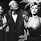 Bella Darvi, Dora Doll, and Jean Tissier in Enigme aux Folies-Bergère (1959)