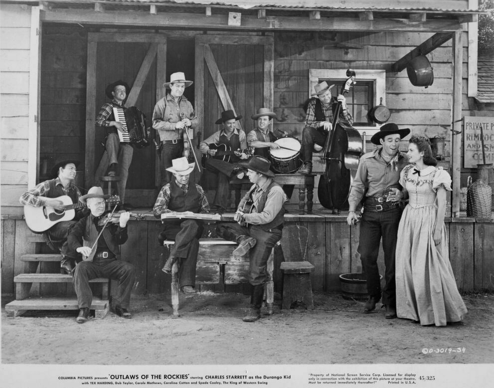 Hank Caldwell, Spade Cooley, Carole Mathews, Tex Harding, Andy Parker, Deuce Spriggins, Tex Williams, Charlie Morgan, Frank Buckley, Tex Atchison, Bud Longley, Tommy Mills, and Ralph Miele in Outlaws of the Rockies (1945)