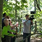 Director Loren Molloy explains the next scene to actor Lyon Beckwith while Cameraman Dan Guindon gets his camera ready.