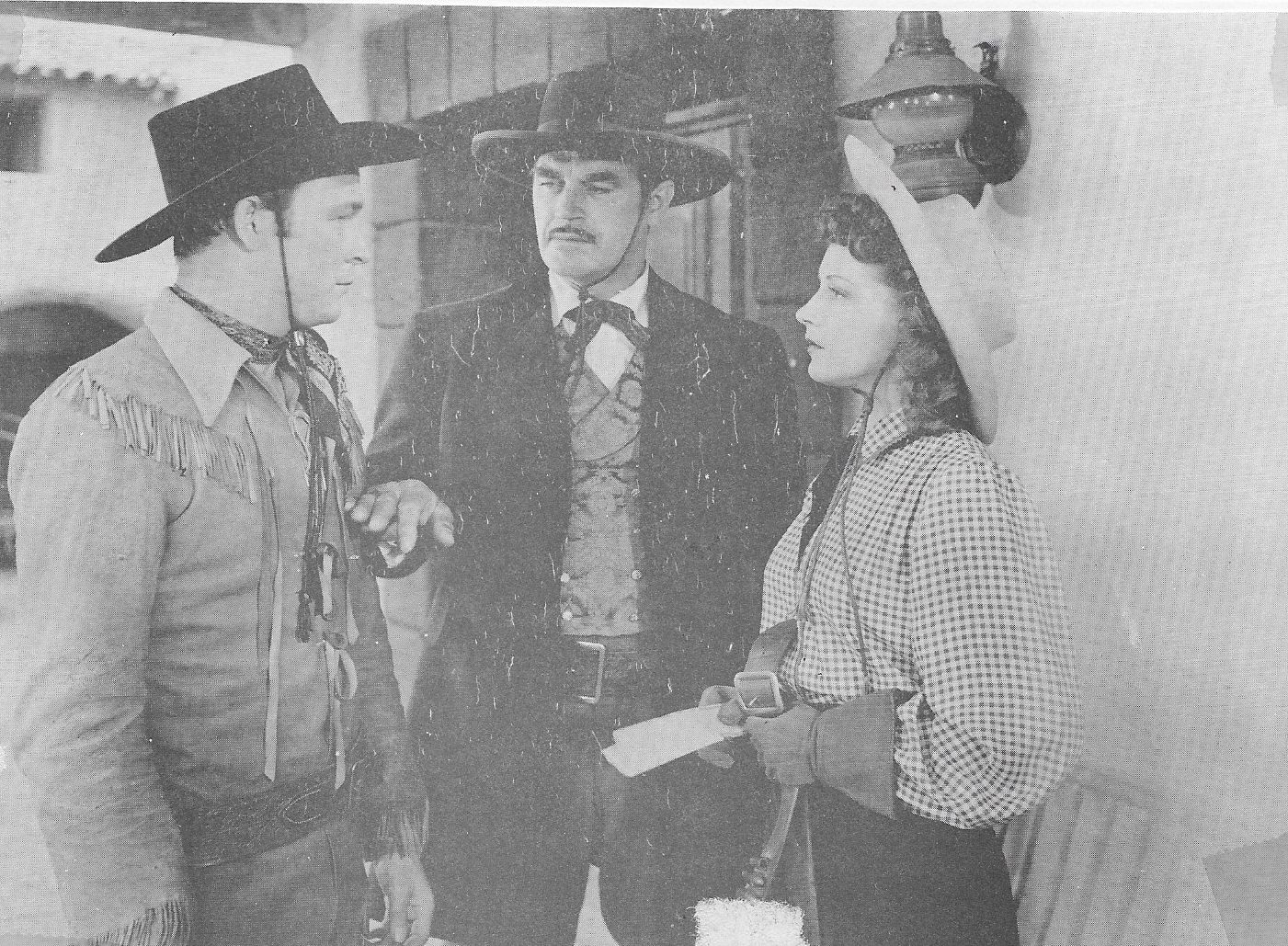 Roy Rogers, Julie Bishop, and Harry Woods in The Ranger and the Lady (1940)