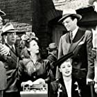 Glenn Miller, Virginia Gilmore, Carole Landis, and Frank Orth in Orchestra Wives (1942)