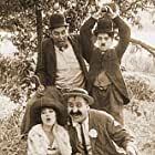 Charles Chaplin, Mabel Normand, and Mack Swain in The Fatal Mallet (1914)