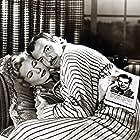 Joan Fontaine, Robert Ryan, and Zachary Scott in Born to Be Bad (1950)