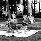 Stéphane Audran, Michel Bouquet, and Stéphane Di Napoli in La femme infidèle (1969)