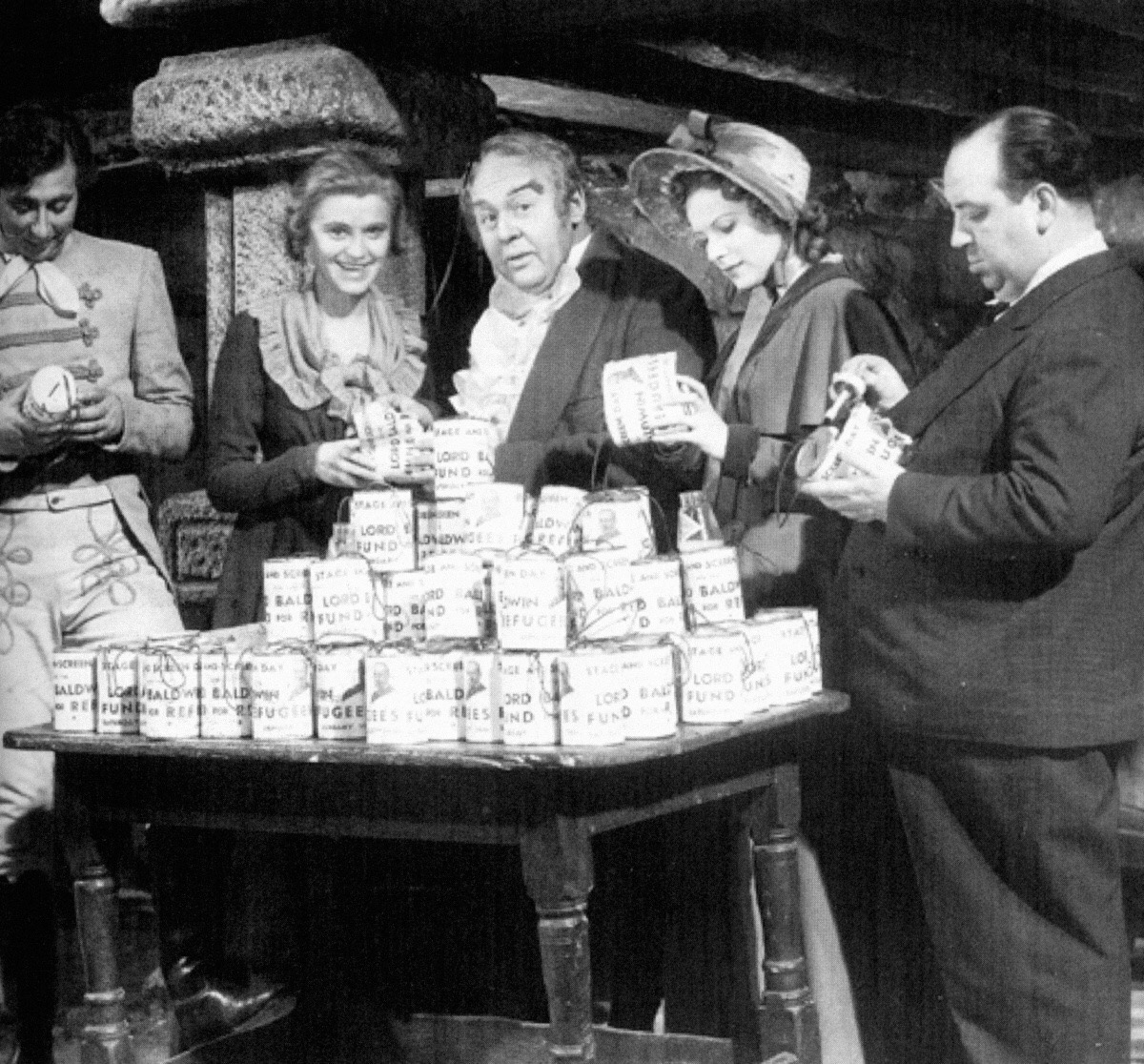 Robert Newton, Marie Ney, Charles Laughton, Maureen O'Hara and Alfred Hitchcock pose for Lord Baldwin's Fund for Refugees on the set of Jamaica Inn