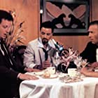 Christopher Plummer, Fisher Stevens, Arielle Dombasle, and Daniel Stern in The Boss' Wife (1986)