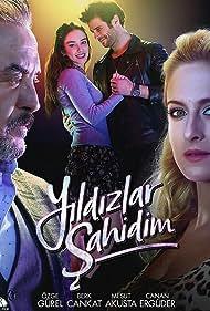 Mesut Akusta, Canan Erguder, Berk Cankat, and Özge Gürel in Yildizlar Sahidim (2017)