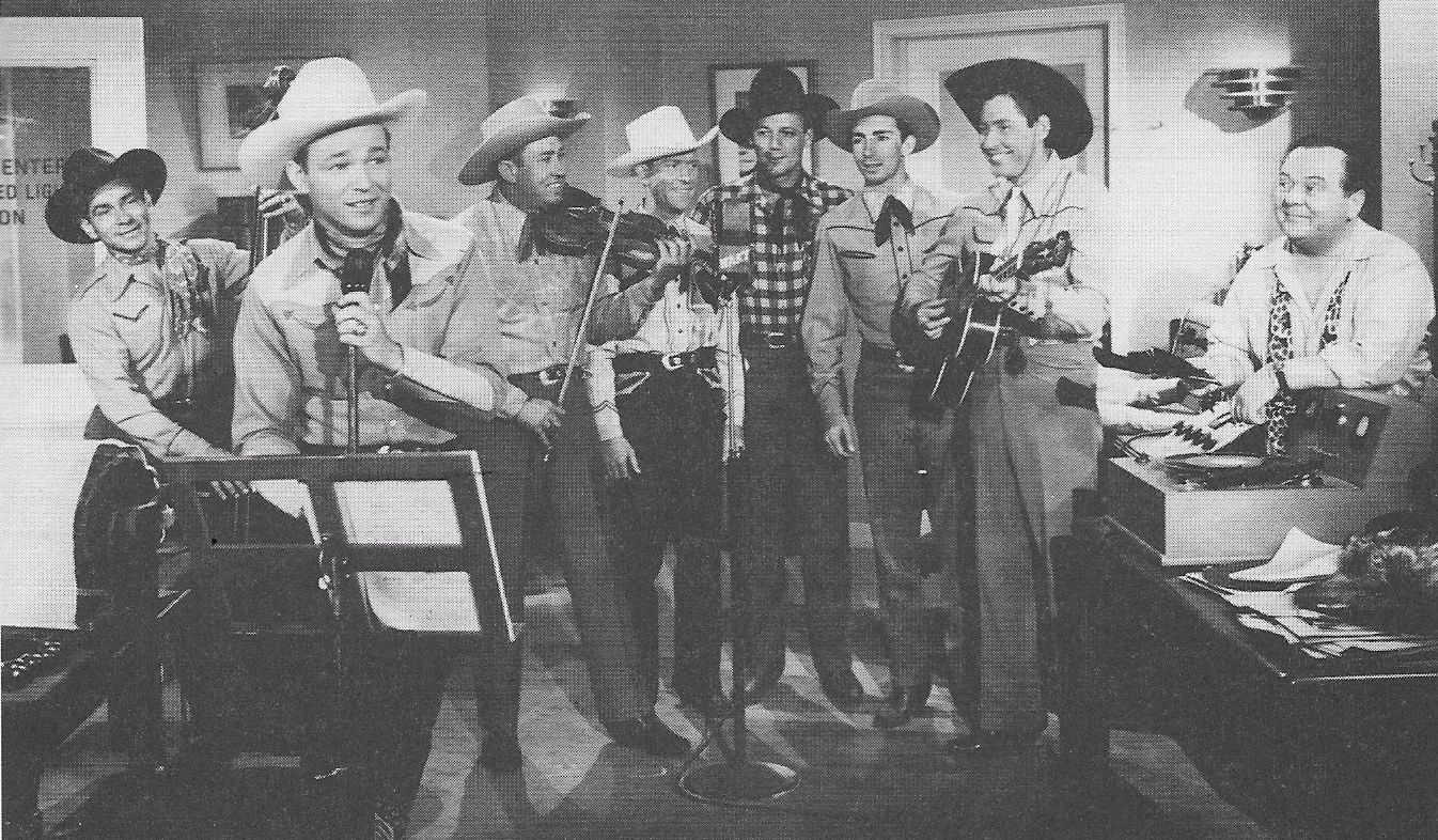 Roy Rogers, Ken Carson, Lloyd Corrigan, Hugh Farr, Karl Farr, Shug Fisher, Bob Nolan, Sons of the Pioneers, and Tim Spencer in Lights of Old Santa Fe (1944)