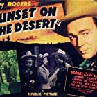 Roy Rogers, Lynne Carver, George 'Gabby' Hayes, and Beryl Wallace in Sunset on the Desert (1942)