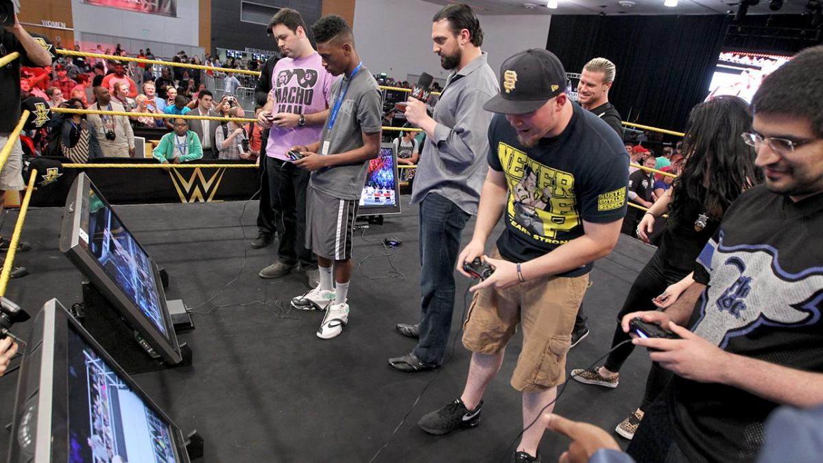 Nic Nemeth and Aron Stevens at an event for WWE 2K15 (2014)