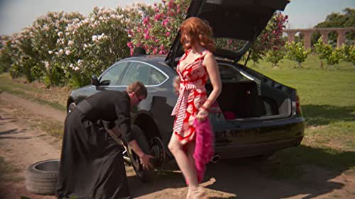 A Sexy Lady and a young priest with a flat tire.