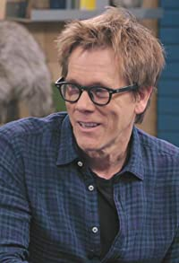 Primary photo for Kevin Bacon Wears a Blue Button Down Shirt and Brown Boots
