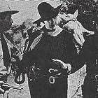 Tim McCoy, Paul Ellis, and Julian Rivero in Arizona Gang Busters (1940)
