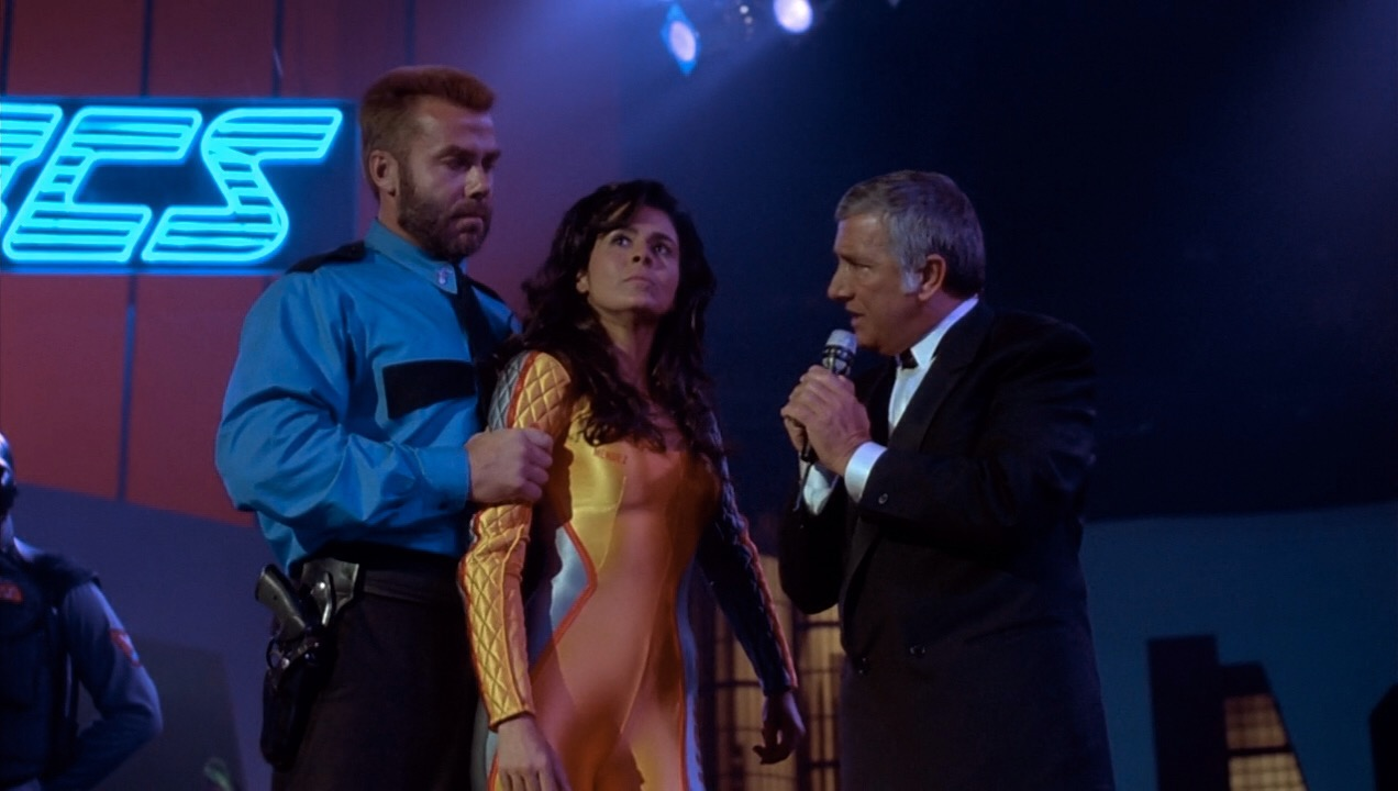 Maria Conchita Alonso, Richard Dawson, and Sven-Ole Thorsen in The Running Man (1987)