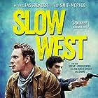 Michael Fassbender, Edwin Wright, and Kodi Smit-McPhee in Slow West (2015)