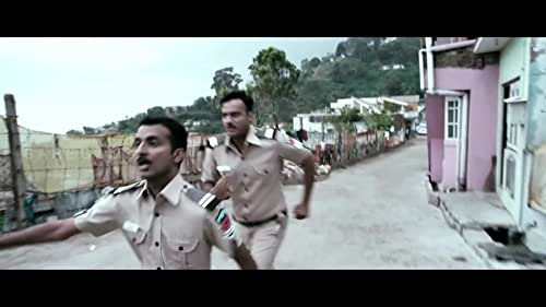 Two police constables try to solve a murder case in a village.