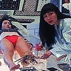 Amy Yip and Siu-dan Hui in Nu ji xie ren (1991)