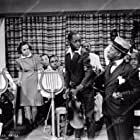 Tommie Moore, Clarence Muse, and William Washington in Broken Strings (1940)