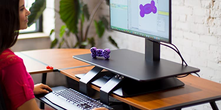 LEVO SIT STAND DESK TOPPER - Join the sit-stand revolution in style. A simple touch raises or lowers your desk to the perfect height, so youll be able to ...