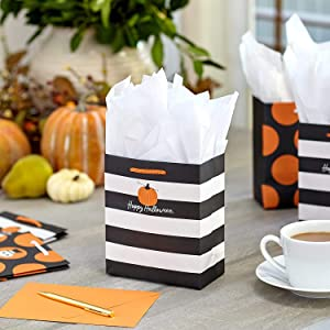 Cute Halloween treat bags with black and white stripes and orange pumpkin