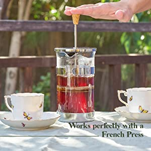 Loose leaf Assam black tea being brewed in a French Press.