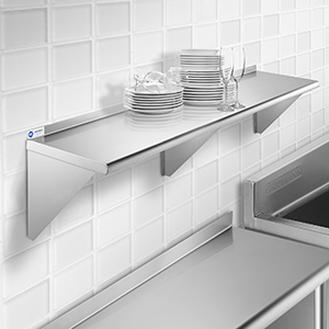 Gridmann hitchen, stainless steel table, sink, wall mount shelf, white tile, dishes, glass ware