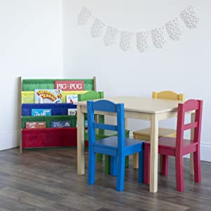 Playroom with primary colored kids table & chair set and 4-tiered shelf bookrack