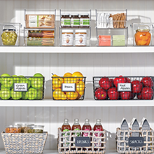 White Kitchen Pantry Shelves with Clear Plastic, Metal Wire, and Woven Storage Baskets Holding Food