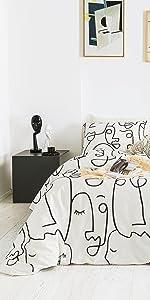 white black abstract face duvet cover set