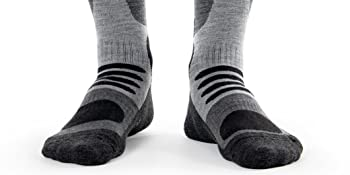Close-up of person's feet wearing Occulto Skiing Socks for Men