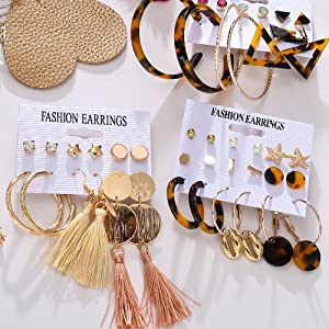 The fashion earring set combines tassels, leather leaf, shells, acrylic, resin