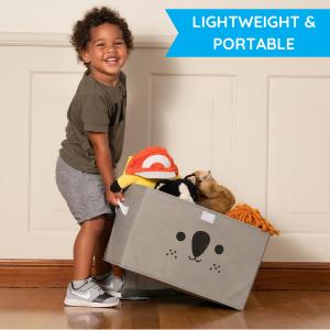 boy picking up toy box