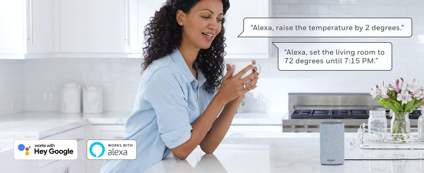 Woman speaking to Alexa in kitchen